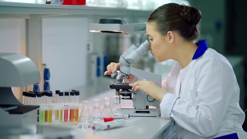 Female scientist with microscope in lab. Woman scientist doing microscope research. Science laboratory research | Shutterstock HD Video #24615257