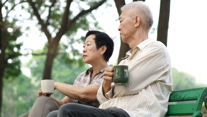 Slow motion tired and worry senior elder couple sitting, drinking coffee. Life after retirement, financial and future planning