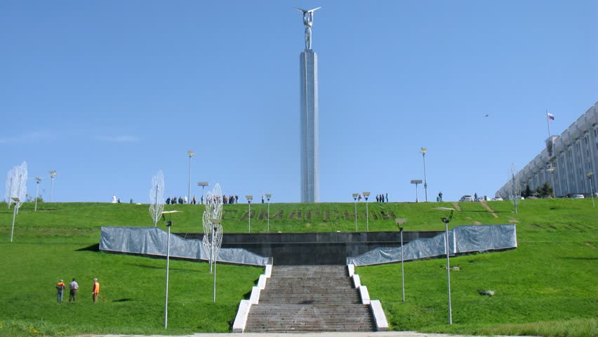 SAMARA - MAY 5: (Timelapse View) Tourists walk near Glory Monument on Glory Square, on May 5, 2012 in Samara, Russia. Monument height - 53 meters
