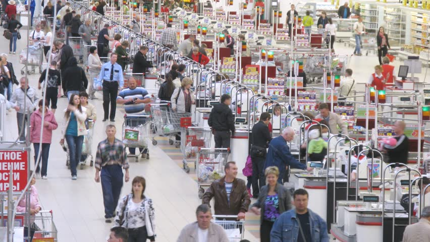 SAMARA - MAY 5: (Timelapse View) People carry carts with products to cash desk in Auchan superstore, on May 5, 2012 in Samara, Russia. In Russia there are currenly 50 Auchan superstores.