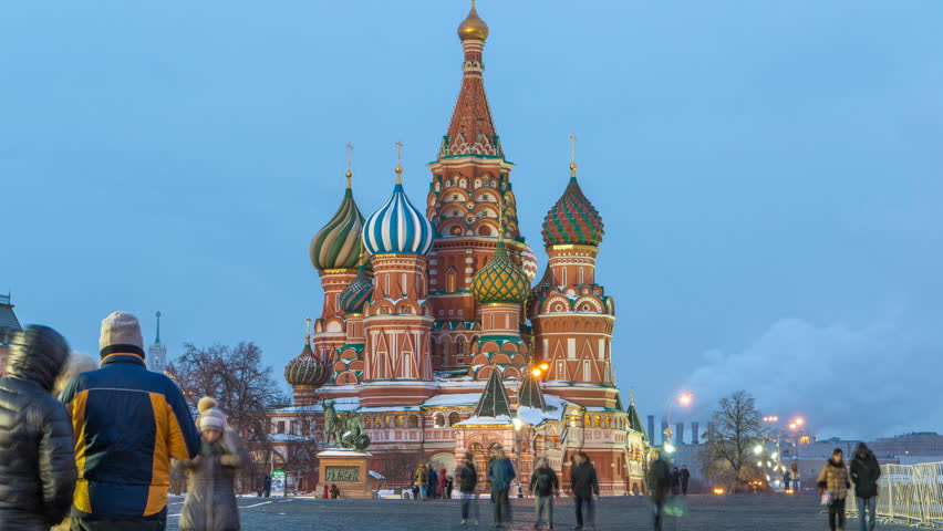 Red Square in winter day to night transition timelapse with illuminated Cathedral of St. Basil, Moscow, Russia