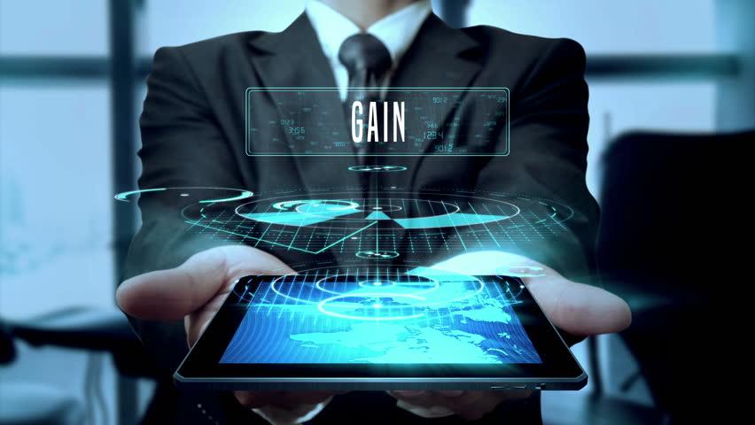 Gain Profit Winnings Earnings Concept Businessman Using Hologram Tablet Technology - Loop | Shutterstock HD Video #24631553