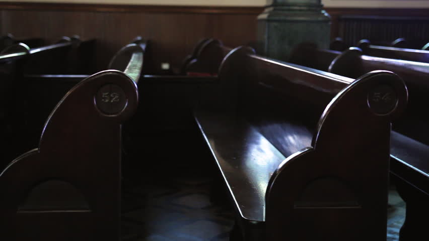 Interior dolly of old wooden church pews
