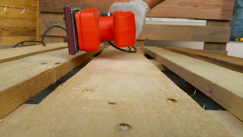 Wood sanding machines , Carpenter working with electrical sander on pine floor or table surface | Shutterstock HD Video #24645170