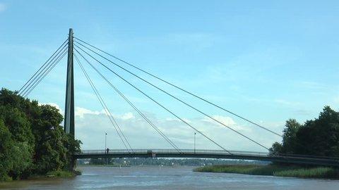 HELSINKI, FINLAND - July 12, 2016: Bridge Matinkaari through Vanhankaupunginlahden gulf, timelapse.  Summer sunny day. Editorial use.