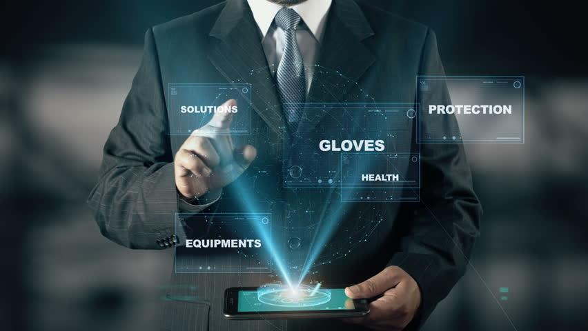 Businessman with Work Safety hologram concept choose Gloves from words | Shutterstock HD Video #24658586