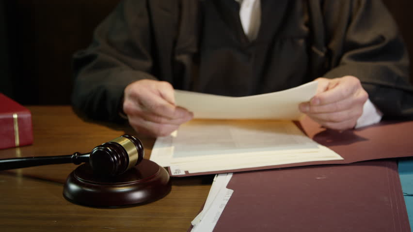Judge closes up folder and hammers his gavel to end court case