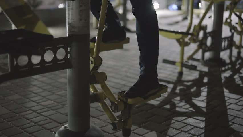 Concentrated young athlete training legs outdoors at the playground using sports equipment | Shutterstock HD Video #24680732