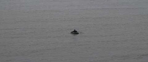 Fisherman at sea, in Latvia.