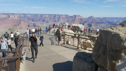 Grand Canyon Village, Arizona - Mather Point - October 26 2016. On a blue sky day, tourists visit Mather Point and enjoy the view and overlook of the South Rim of the Grand Canyon.
