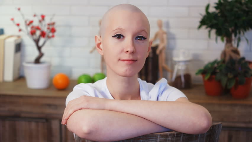 Portrati of a happy cancer survivor woman sitting on a chair, smiling and looking into the camera | Shutterstock HD Video #24695504
