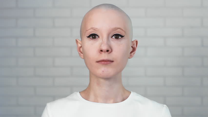 Portrait of a happy cancer survivor woman smiling and looking into the camera | Shutterstock HD Video #24695591