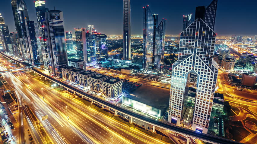 Spectacular nighttime skyline of Dubai. UAE. Top view of business bay skyscrapers and highway with car trails . 4K time lapse. Famous travel destination.  #24718439