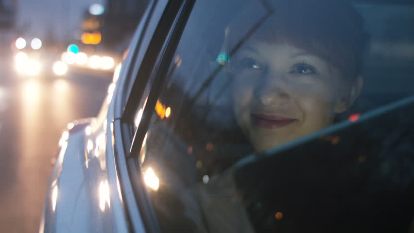 Young Woman Looking Through a Window and Smiling Royalty-Free Stock Footage #24721703