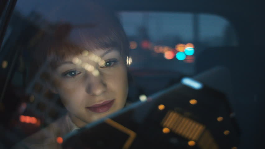 Woman Using a Tablet and Looking Through a Window Royalty-Free Stock Footage #24721739