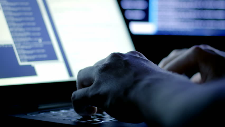 Close-up of programmer's hands typing commands. Young man using the keyboard while processing new data late at night. Royalty-Free Stock Footage #24752027