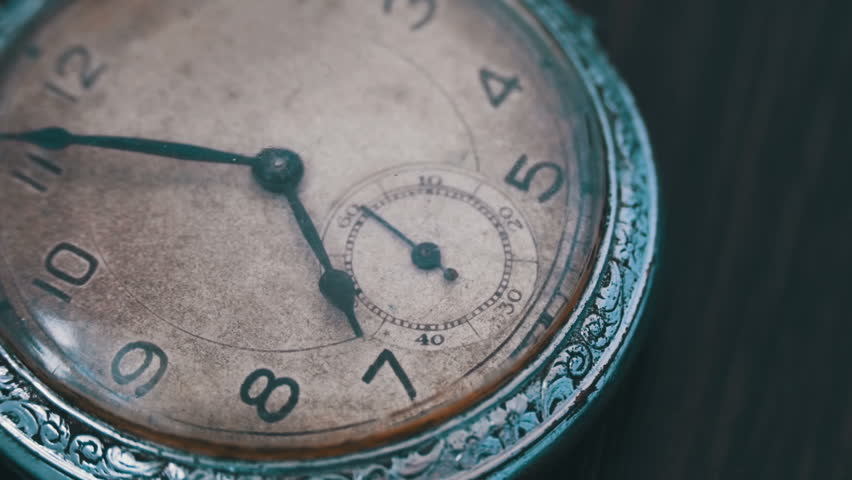 A macro closeup of an vintage clock.Antique clock dial close-up. Vintage pocket watch.Old vintage clock mechanism watch time going fast,clock mechanism working, closeup shot with soft focus | Shutterstock HD Video #24758651