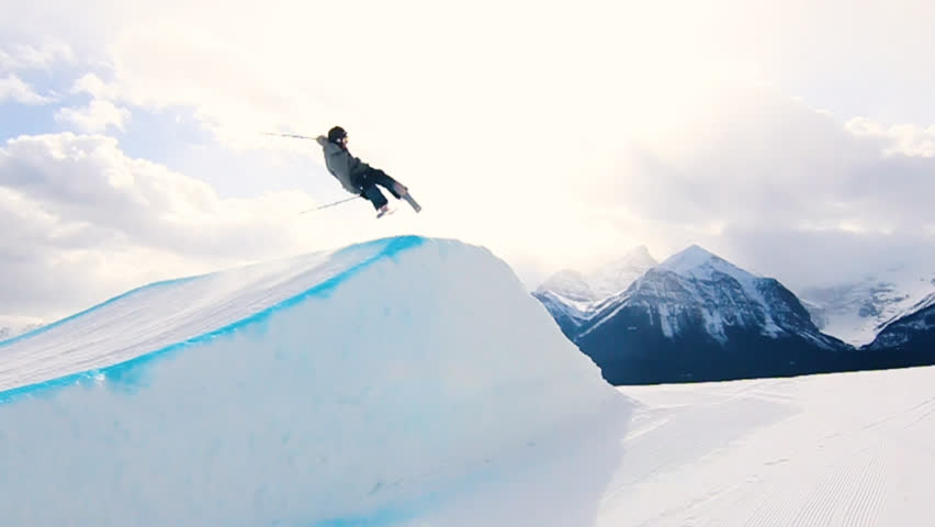 Male Freestyle Skier Does Big Flip While Going Backwards Fast on Jump at Lake Louise in Banff Alberta Canada