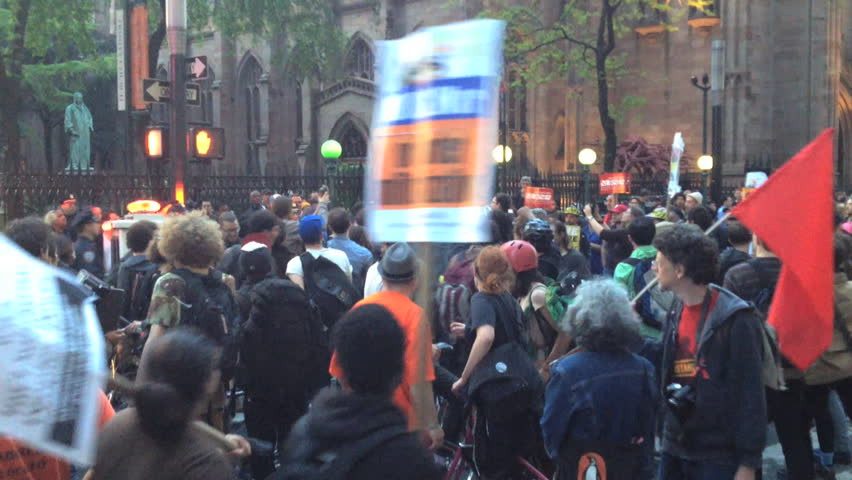 NEW YORK - MAY 1, 2012: Occupy Wall Street Protestors march down Broadway as police and protestors confront each other