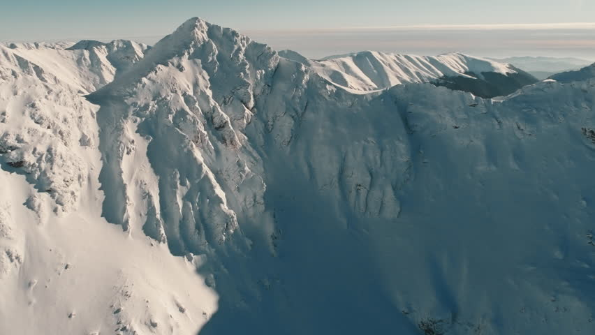 Aerial drone shot over famous Fagaras mountains covered with snow in wintertime