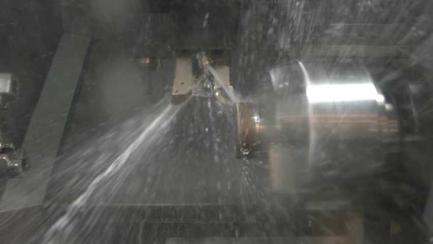 Lathe in action closeup. Splashes of water. Cnc machine coolant.   Shutterstock HD Video #24778307