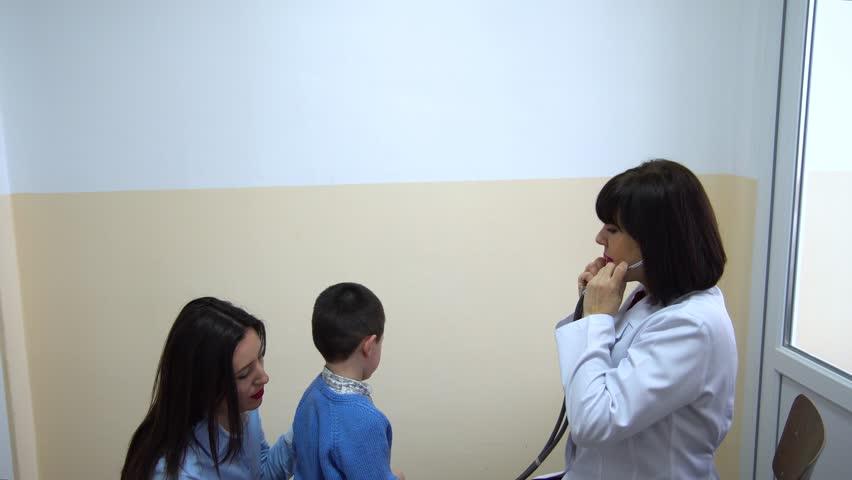 Clinic. Doctor examines a little boy. | Shutterstock HD Video #24785042