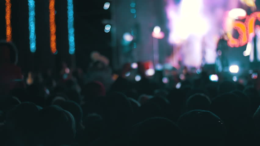 Blurred Concert Crowd at Music Festival. Crowd people dancing Rock concert, weighed, applauds, raises his hands up and photographed, filmed concert on the phones and smartphones. Party People In Action. Crowd | Shutterstock HD Video #24792683