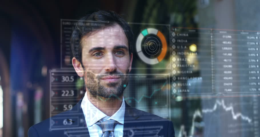 A businessman in a suit uses holography and augmented reality to see in 3D graphics financial economics. Concept: immersive technology, business, economy, futuristic lessons and future. | Shutterstock HD Video #24793670