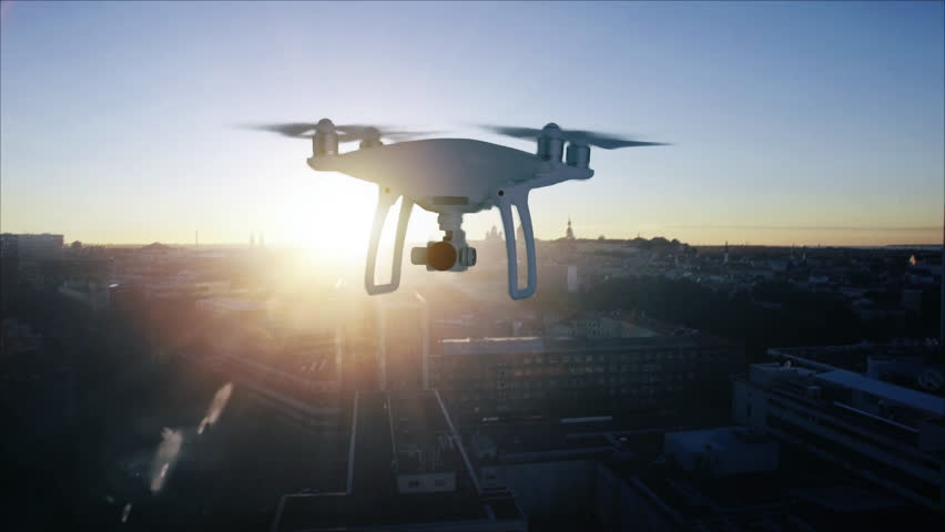 Aerial Shot: a Drone Flying over Modern City Delivering Packages. Contactless Delivery Concept People Receiving Medical Aid, Essentials, Disaster Relief or Food Delivery in Rural Areas