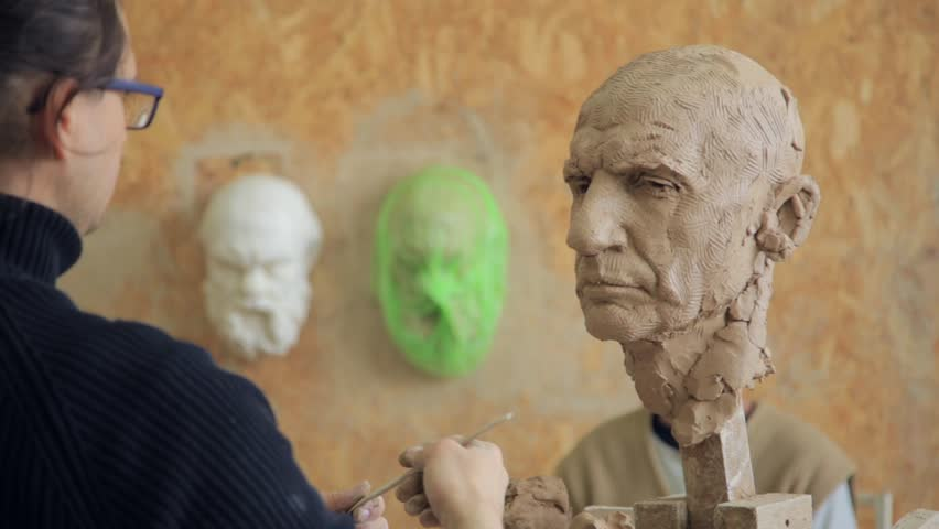 Sculptor modelling sculpture adjusting face details head made of clay. Creative concept. | Shutterstock HD Video #24796112