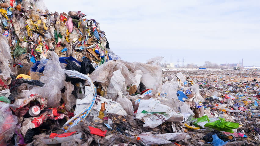Big piles of garbage. Plastic, packages, polyethylene in a garbage dump. Dolly shot.   Shutterstock HD Video #24819668