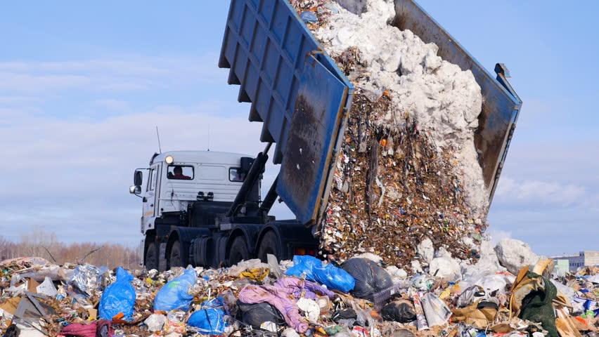 4K. Truck offloading waste into a huge landfill.   Shutterstock HD Video #24819701