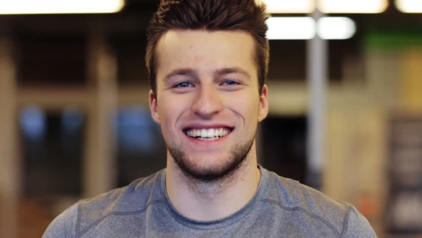 Sport, fitness, emotion, expression and people concept - happy smiling young man touching his had at gym | Shutterstock HD Video #24849224