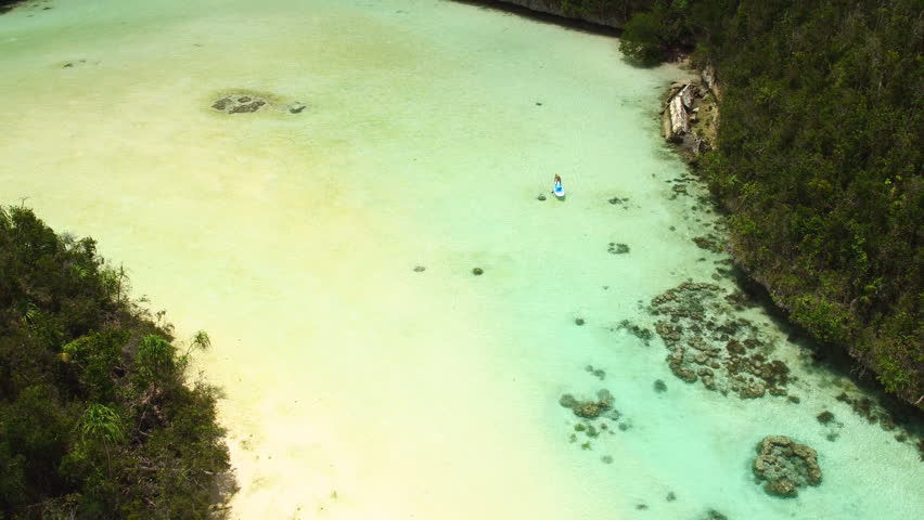 Aerial - Young woman paddleboarding SUP in crystal clear turquoise water - Indonesia | Shutterstock HD Video #24855323