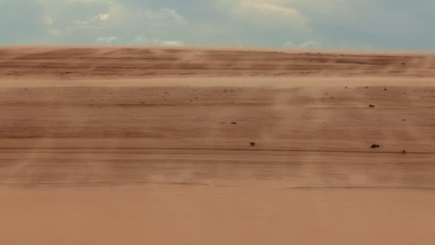Desert landscape. Sahara winds blowing sand. Arid and dry landscape of desert. Blowing sand in mountain dunes.