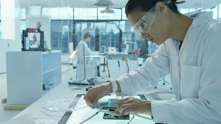 4K Electronics engineers working in lab building & testing circuitry & robotics Royalty-Free Stock Footage #24884453