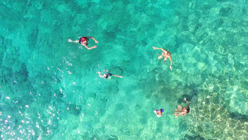 BRAC, CROATIA - JULY 2014: Family of five swimming and playing in turquoise sea | Shutterstock HD Video #24887897