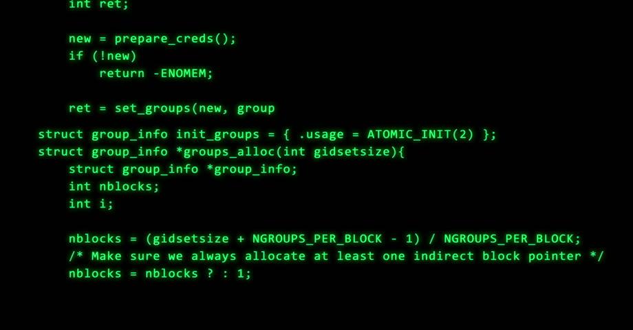 Programming code running down a computer screen terminal