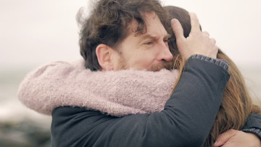Handsome man crying hugging love of his life #24908861