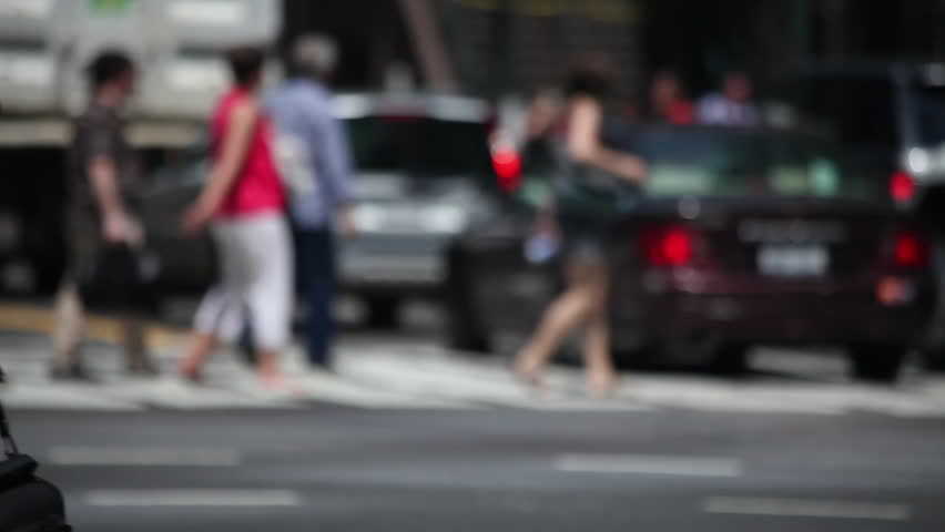 NEW YORK - CIRCA July, 2012: Crowd of people walking crossing street on a sunny day #2491301