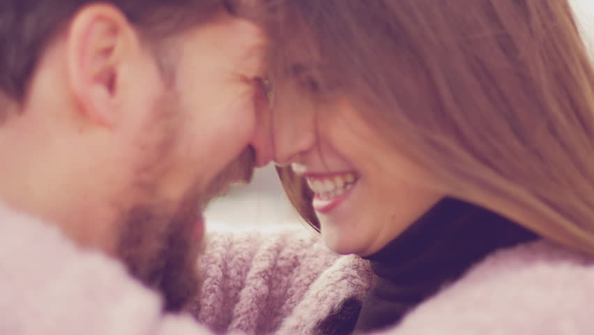 Man and woman nose to nose looking at each other in love romantic magic moment of love extreme closeup   Shutterstock HD Video #24935372