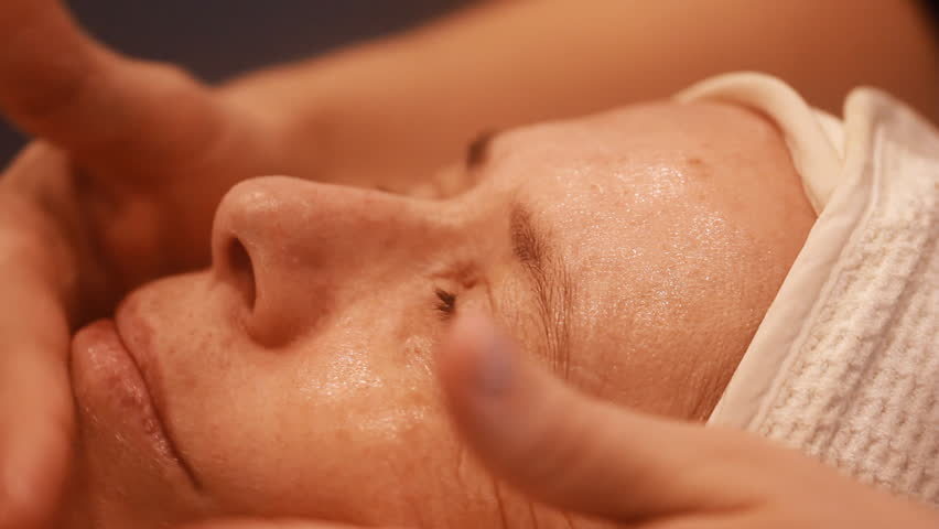 Woman getting a cosmetic peel off mask facial massage at spa salon skincare.  | Shutterstock HD Video #24937190