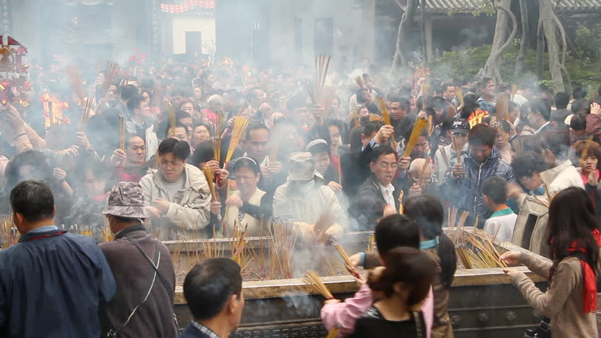 GUANGZHOU - FEBRUARY 3: People burn incense in temple during Chinese New Year on February 3, 2011 in Guangzhou, China.