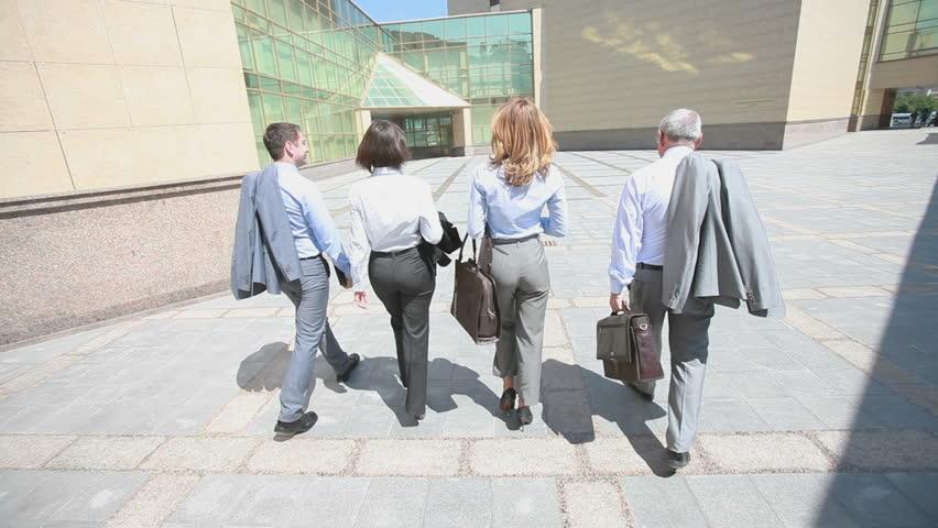 Confident business team walking steadfastly outside in urban surroundings | Shutterstock HD Video #2498096