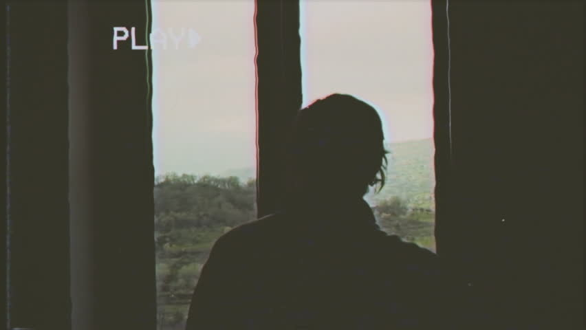 Fake VHS tape: a man opens a window and contemplates the mountainous scenery outside.  | Shutterstock HD Video #24983654