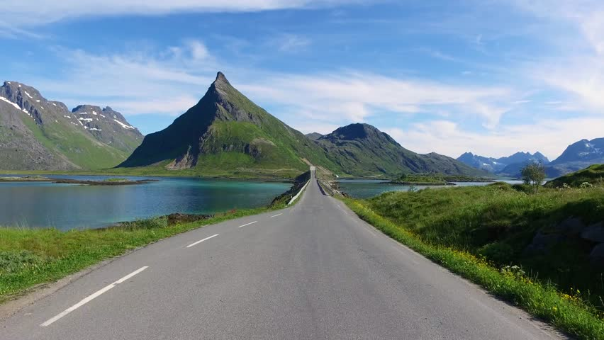 Driving a Car on a Road in Norway Lofoten