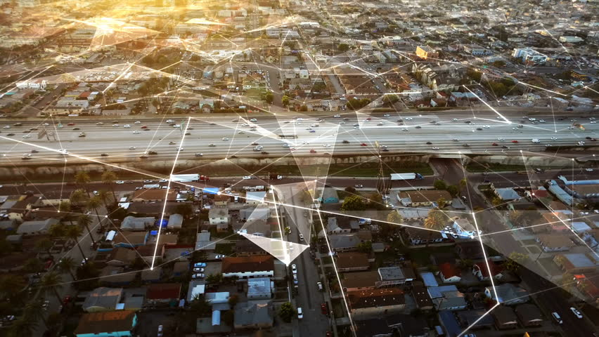 Connected freeway at sunset in Los Angeles, California. Traffic passing by. Aerial footage. United States. Futuristic. Technology. #25021214