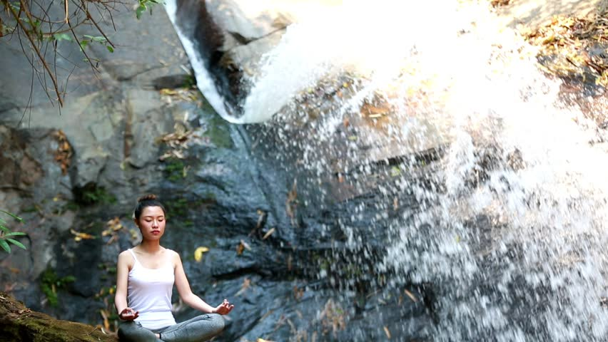 Woman Yoga - relax in waterfall nature | Shutterstock HD Video #25021262