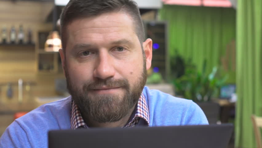 Focused man browsing tablet, look to camera portrait, cafe, pub, close steadicam | Shutterstock HD Video #25041044