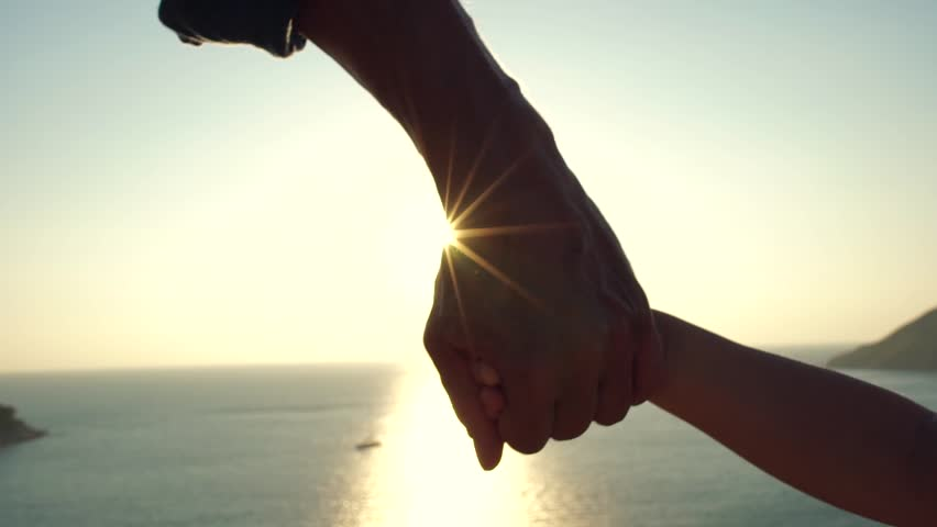 Close up hand of the father holding the child's hand. Slow motion | Shutterstock HD Video #25043360